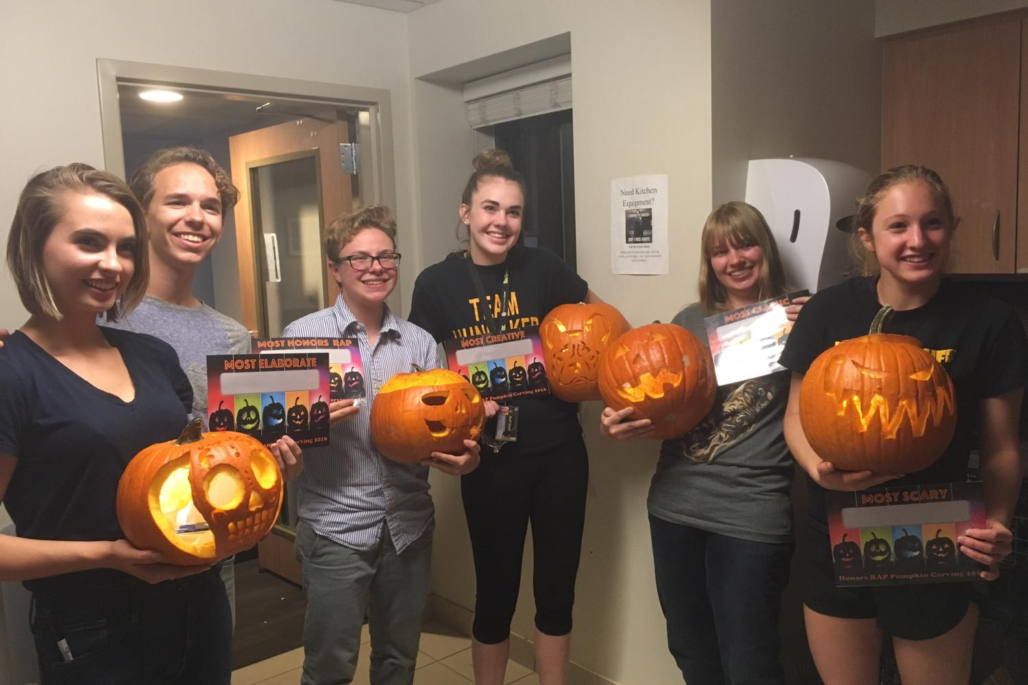 Students with pumpkin carving certificates