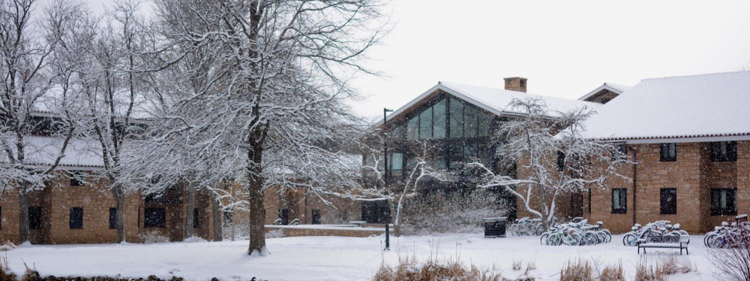 snowy winter view of Smith Hall and pond