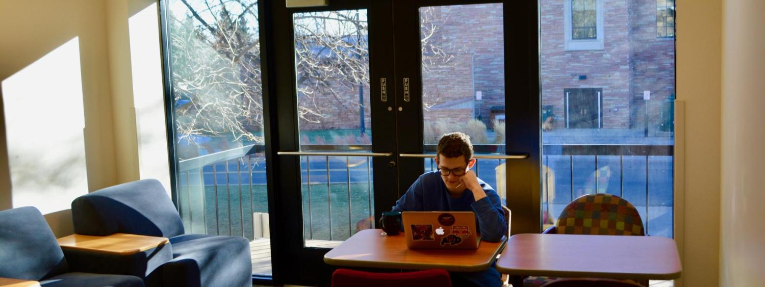 One student studying in a study lounge in Smith Hall