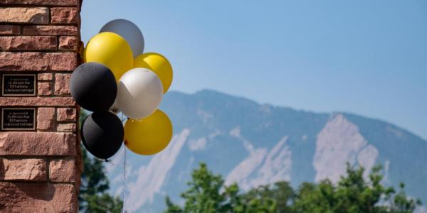 Balloons adorn the entrance to Farrand Field for the 2018 Finding Your Fit event for new students. (Photo by Glenn Asakawa/University of Colorado)