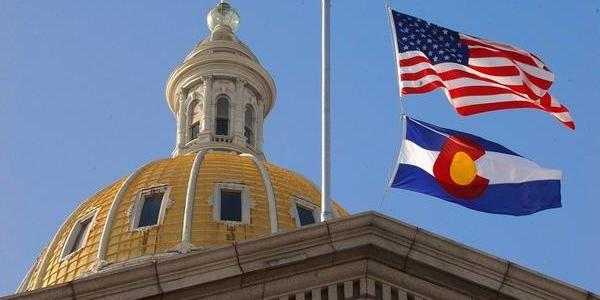 denver capitol with us and colorado flag