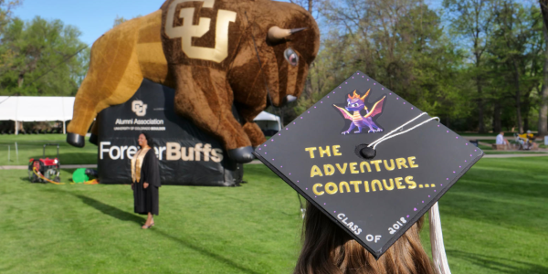 Scenes from the 2018 CU Boulder main commencement that starts in the Norlin Quad and ends at Folsom Field. (Photo by Glenn Asakawa/University of Colorado)