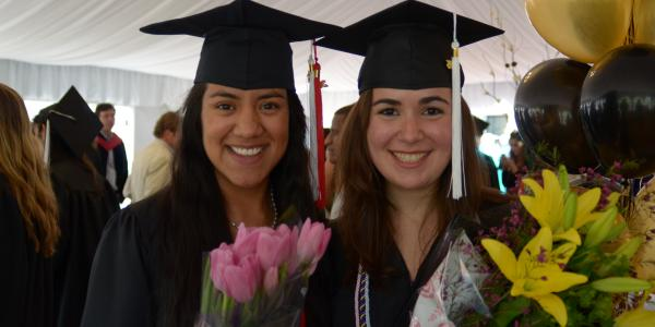 two grads after the ceremony