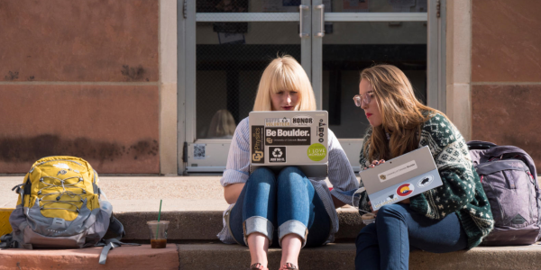 Mary Taggart, a freshman physics major from McKinney, TX, left, and Jessie Pafford, and freshman integrated physiology major from Sanford, NC, study outside of Chem 140. on Nov. 15, 2017. (Photo by Glenn Asakawa/University of Colorado)