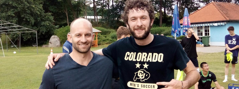 two men on soccer practice field