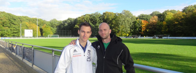 two men on soccer field