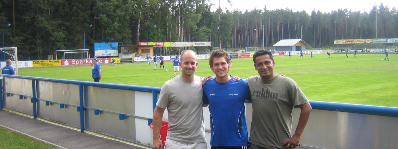 three men on soccer field
