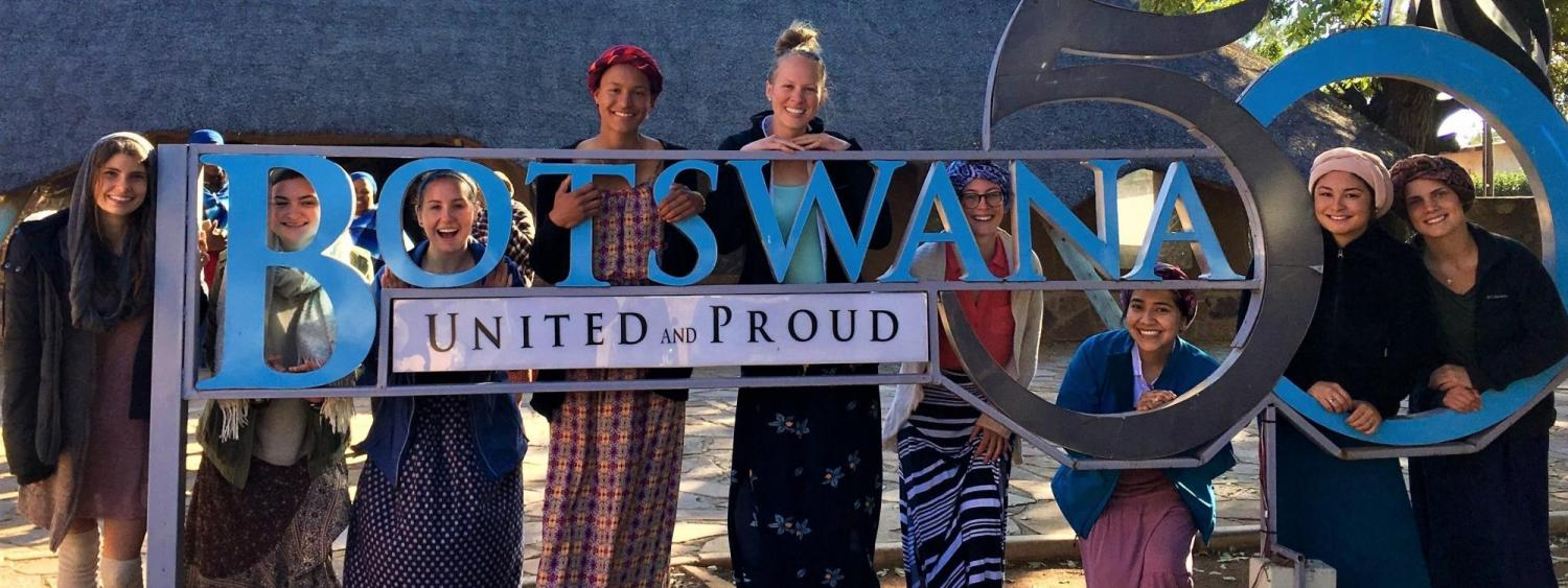 study abroad students standing at the botswana sign