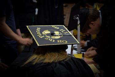 graduation cap with globe