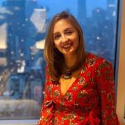 photo of erin neale wearing red dress in windowsill