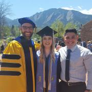 three people at cu graduation