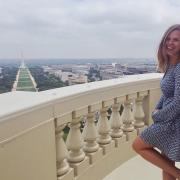 kate henjum standing on balcony overlooking national mall