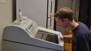 Man looking at lab machine