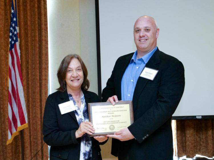 Leadership and Service Award Selection Committee Chair Andrea Feldman and recipient Matthew McQueen