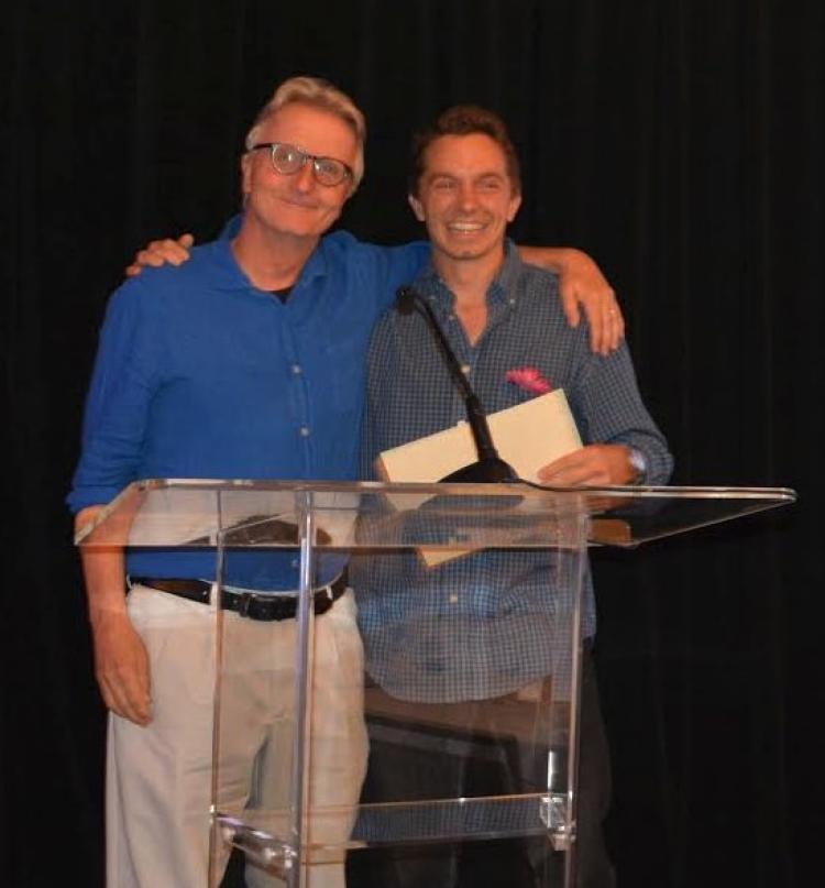 Spencer Huggett accepts the award from Eric Turkheimer