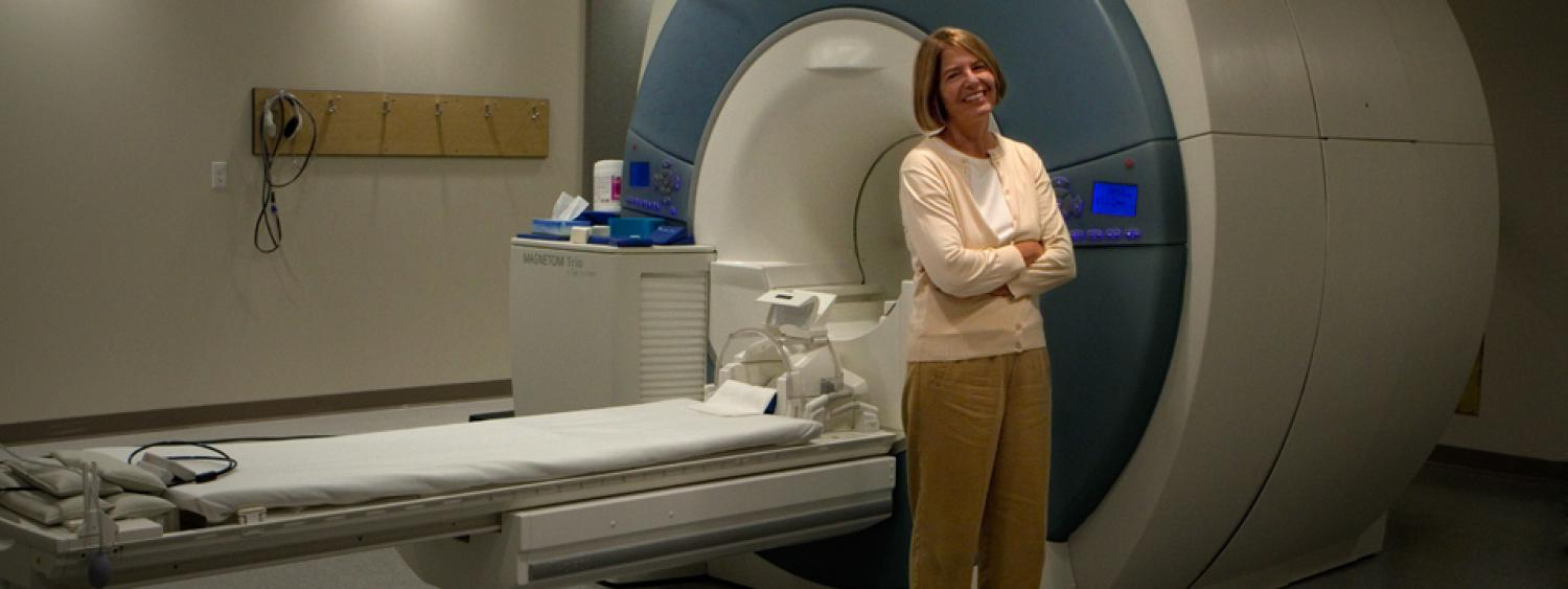 Dr. Banich in front of the INC MRI.