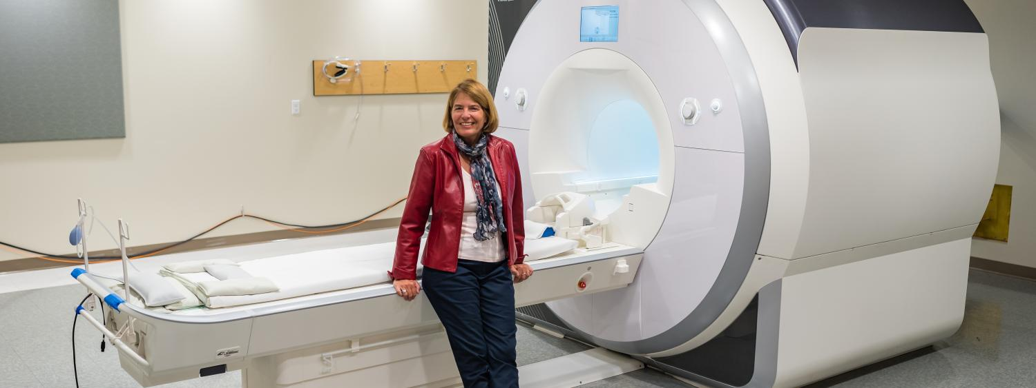Marie Banich in front of the INC MRI.
