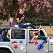 High school students riding a jeep photo credit Glenn Asakawa