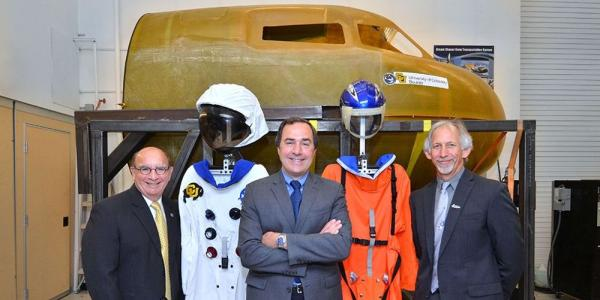 Phil DiStefano stands besides Sierra Nevada exec and Louis Stodieck for Dream Chaser project