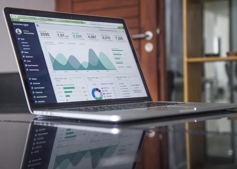 Laptop displaying data visualizations.