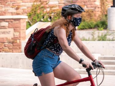 Student biking on campus