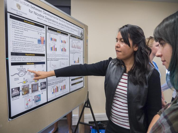 SMART students present their research as a poster