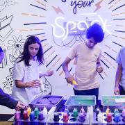 Three students painting at Startup Hub
