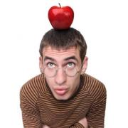 man with glasses with apple on his head