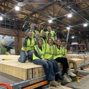 Students on the CU Boulder Solar Decathlon team work on their SPARC house