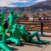 people wearing green costumes
