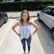girl standing in parking spot