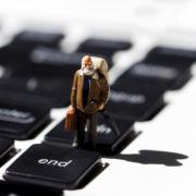 toy man on keyboard