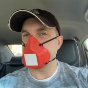 nick schuster wearing facemask