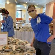 nurse in mask with food