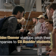 Picture of students and companies talking to each other at Startups2Students event
