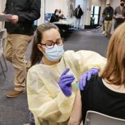 nurse vaccinating person