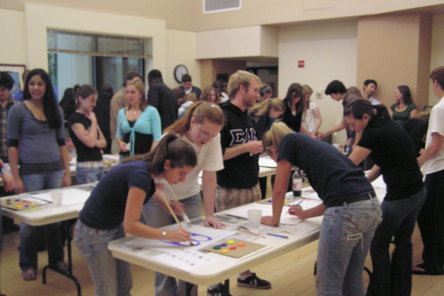 Photo of a Branch Out program where participants are painting