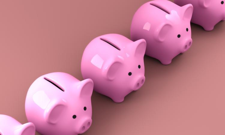 row of pink piggy banks