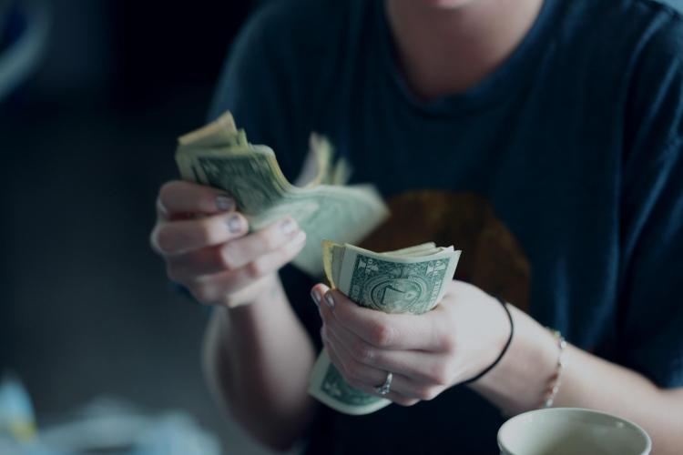 female counting money