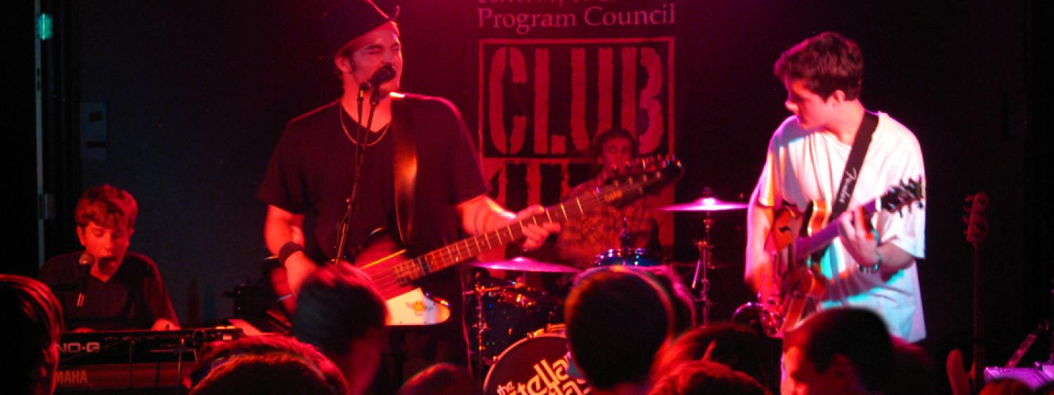 A photo of a local band playing at Club 156, which is an alcohol-free venue on the 1st floor of the UMC.