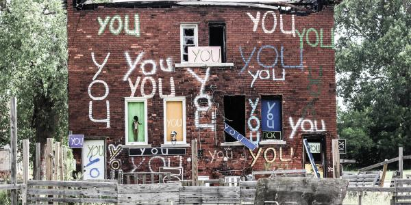 """Building in Detroit with """"You"""" Painted on it many times"""