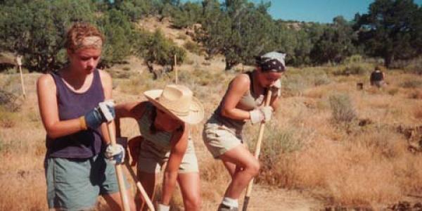 student digging during an INVST summer program on climate justice