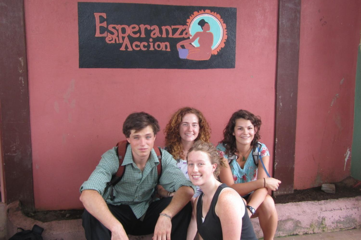 Students in front of a sign