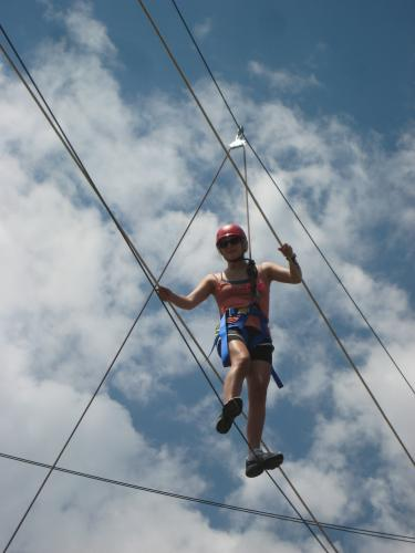Student on a ropes course