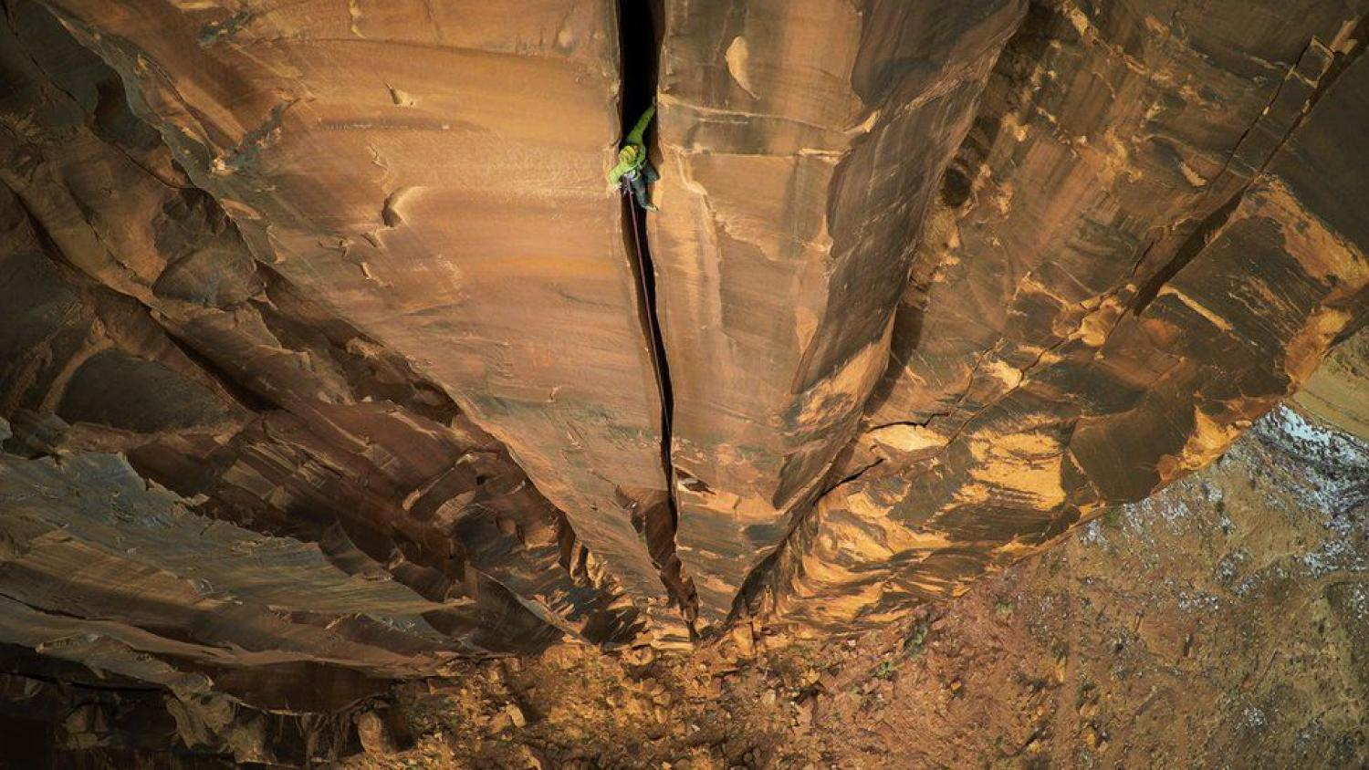 Man in crack at Moab Rock 400 feet off the ground.