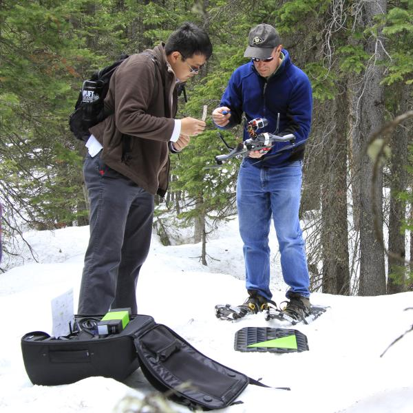 Researches preparing a quadcopter for flight in the forest