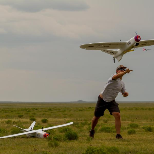 IRISS students Danny L. (left) and Ty G. (right) launching one of three Talons used to test the MUASO (Multi-UAS Ops) ground station