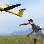 Student launches drone at IRISS flight training.
