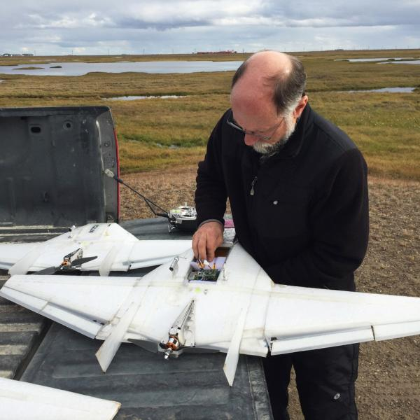 Dale Lawrence working on a drone during testing