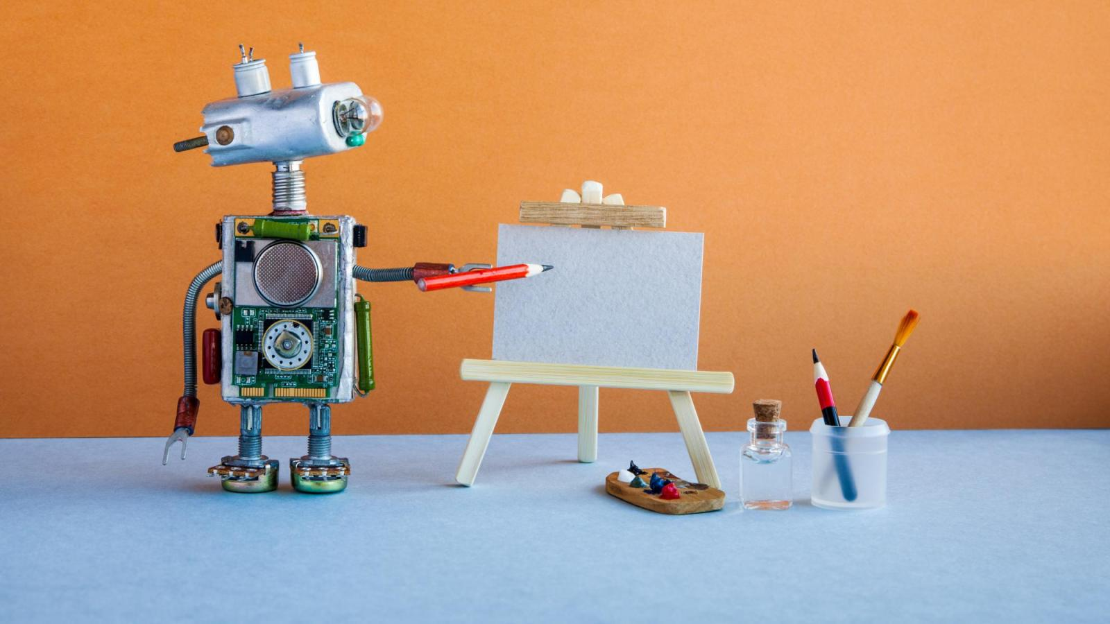 A robot standing with a pencil next to paper